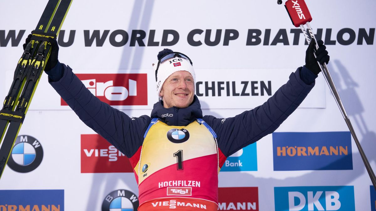 Norway's Johannes Thingnes Boe celebrates on the podium after winning the men 12.5 km pursuit event at the IBU Biathlon World Cup competition in Hochfilzen, Austria, on December 14, 2019.