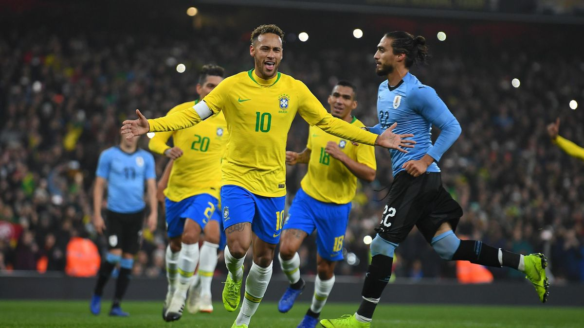 Neymar da Silva Santos Jœnior of Brazil celebrates scoring the opening goal