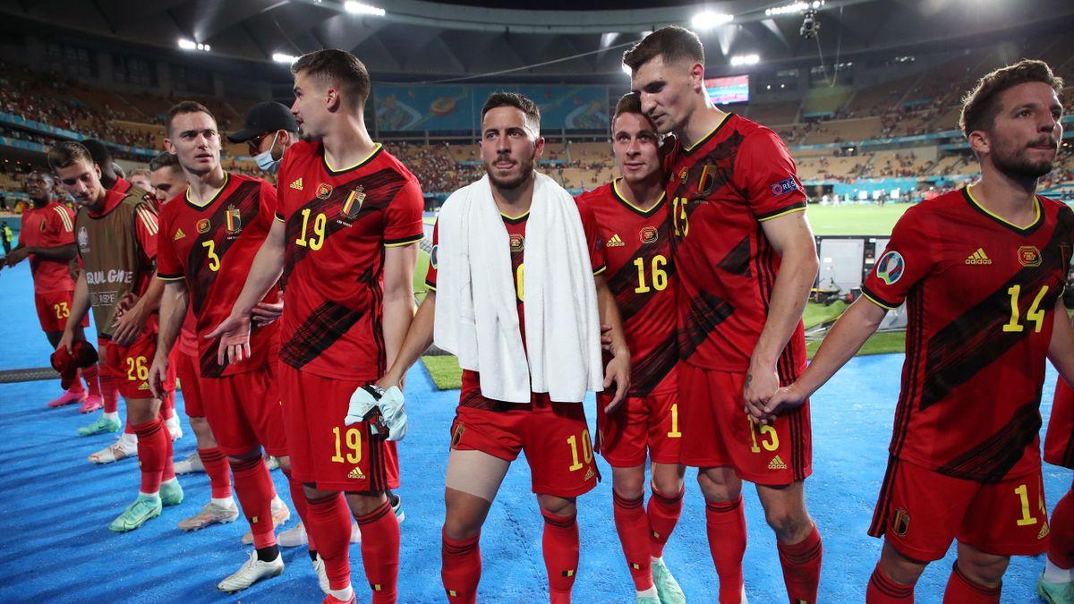 Eden Hazard of Belgium celebrates with Thorgan Hazard of Belgium and Thomas Meunier of Belgium after winning the UEFA Euro 2020 Championship Round of 16 match between Belgium and Portugal at Estadio La Cartuja on June 27, 2021 in Seville, Spain
