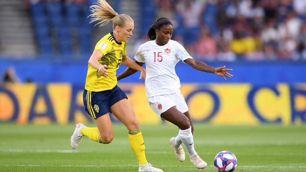 Nichelle Prince of Canada battles for possession with Lina Hurtig of Sweden during the 2019 FIFA Women's World Cup France Round Of 16 match between Sweden and Canada at Parc des Princes on June 24, 2019 in Paris, France.