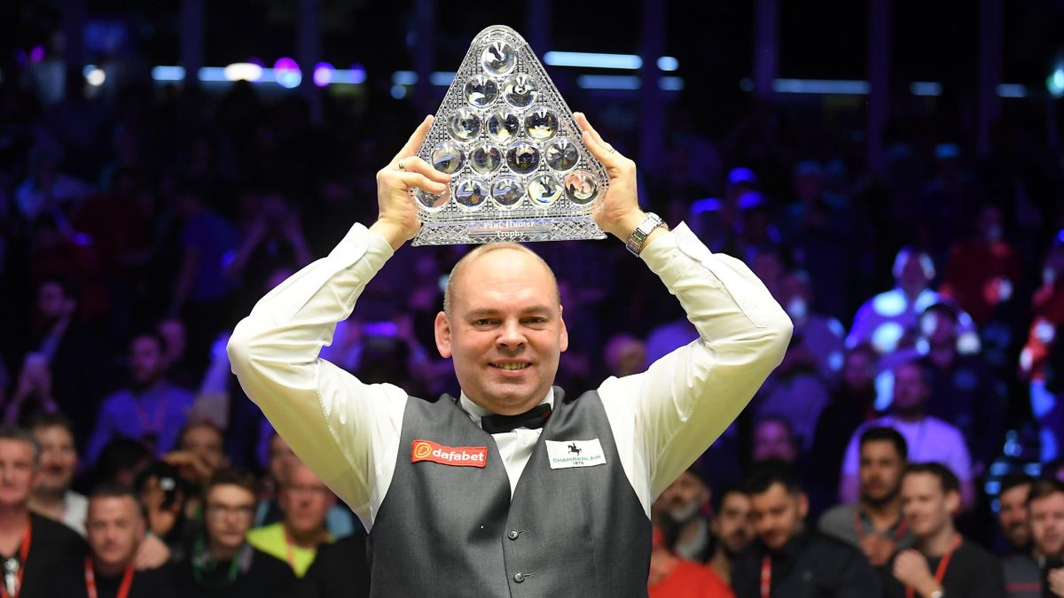 Stuart Bingham poses for a photo with the Paul Hunter Trophy after victory in the Final of the Dafabet Masters between Stuart Bingham and Ali Carter at Alexandra Palace on January 19, 2020 in London, England