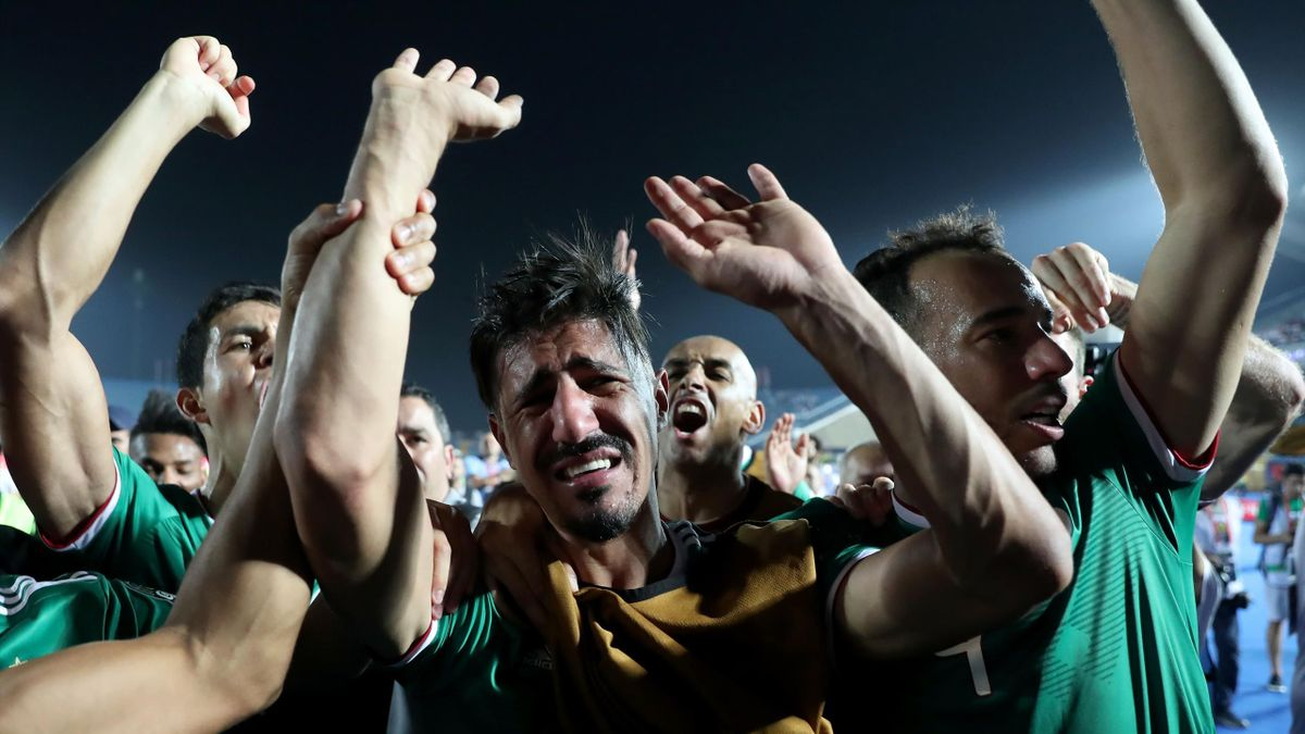 Algeria's forward Baghdad Bounedjah (C) celebrates after winning the 2019 Africa Cup of Nations (CAN) quarter final football match between Ivory Coast and Algeria at the Suez stadium in Suez