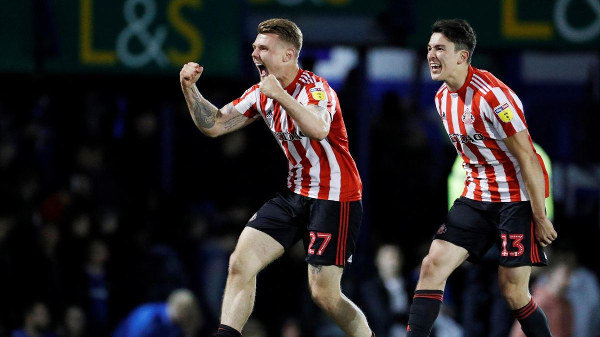 Sunderland's Max Power and Luke O'Nien celebrate after the final whistle