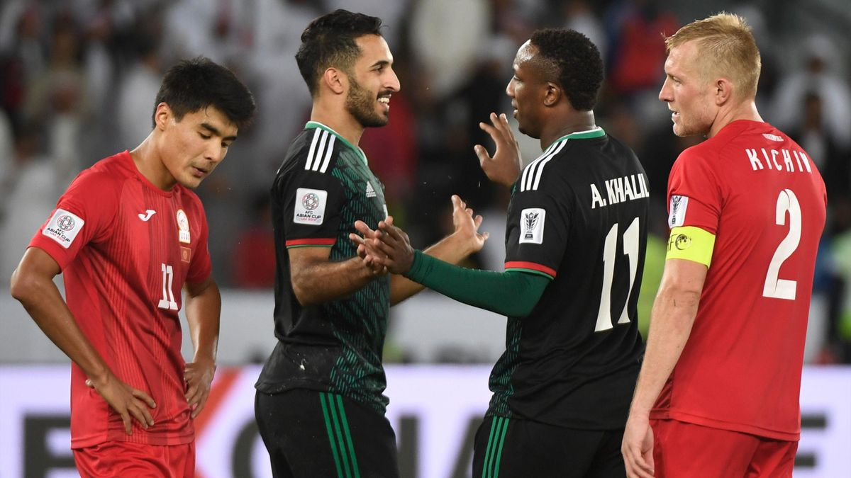Ahmed Khalil (C-R) is congratulated United Arab Emirates' forward Ali Mabkhout (C-L) during the 2019 AFC Asian Cup Round of 16 football match between UAE and Kyrgyzstan at the Zayed Sports City Stadium.