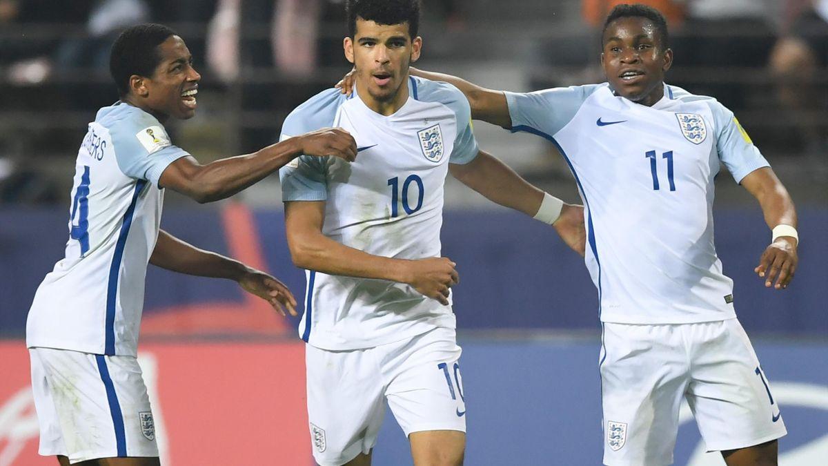 England's defender Kyle Walker-Peters, forward Dominic Solanke and forward Ademola Lookman celebrates a goal