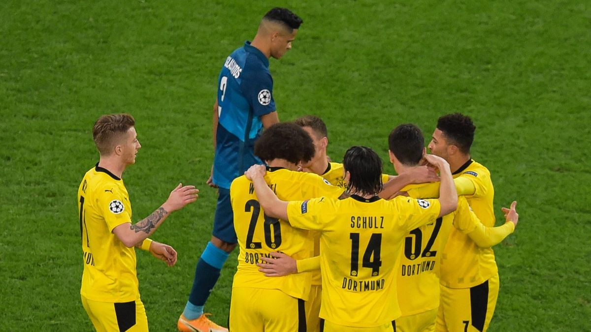 Borussia Dortmund's Belgian midfielder Axel Witsel celebrates with teammates after scoring the team's second goal during the UEFA Champions League football match between Zenit St. Petersburg and Borussia Dortmund at the Saint Petersburg Stadium (Gazprom A