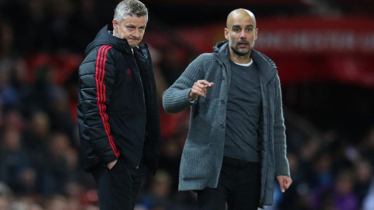 Ole Gunnar Solskjaer (Manchester United, li.) und Pep Guardiola von Manchester City