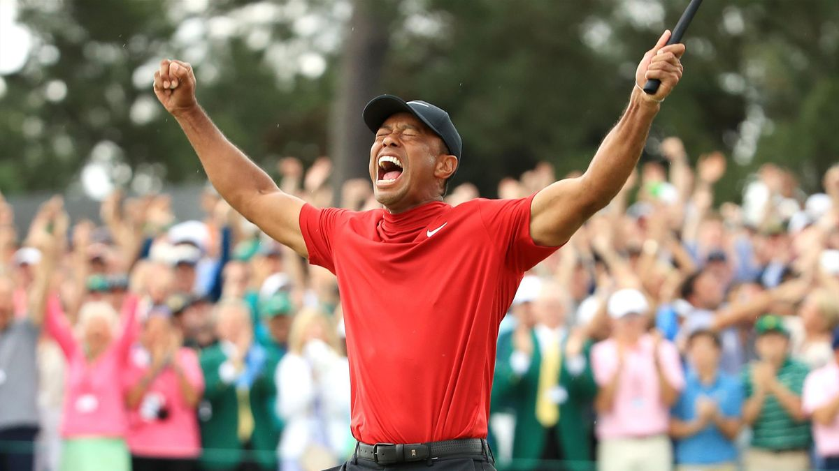Tiger Woods of the United States celebrates after sinking his putt to win during the final round of the Masters at Augusta National Golf Club on April 14, 2019 in Augusta, Georgia