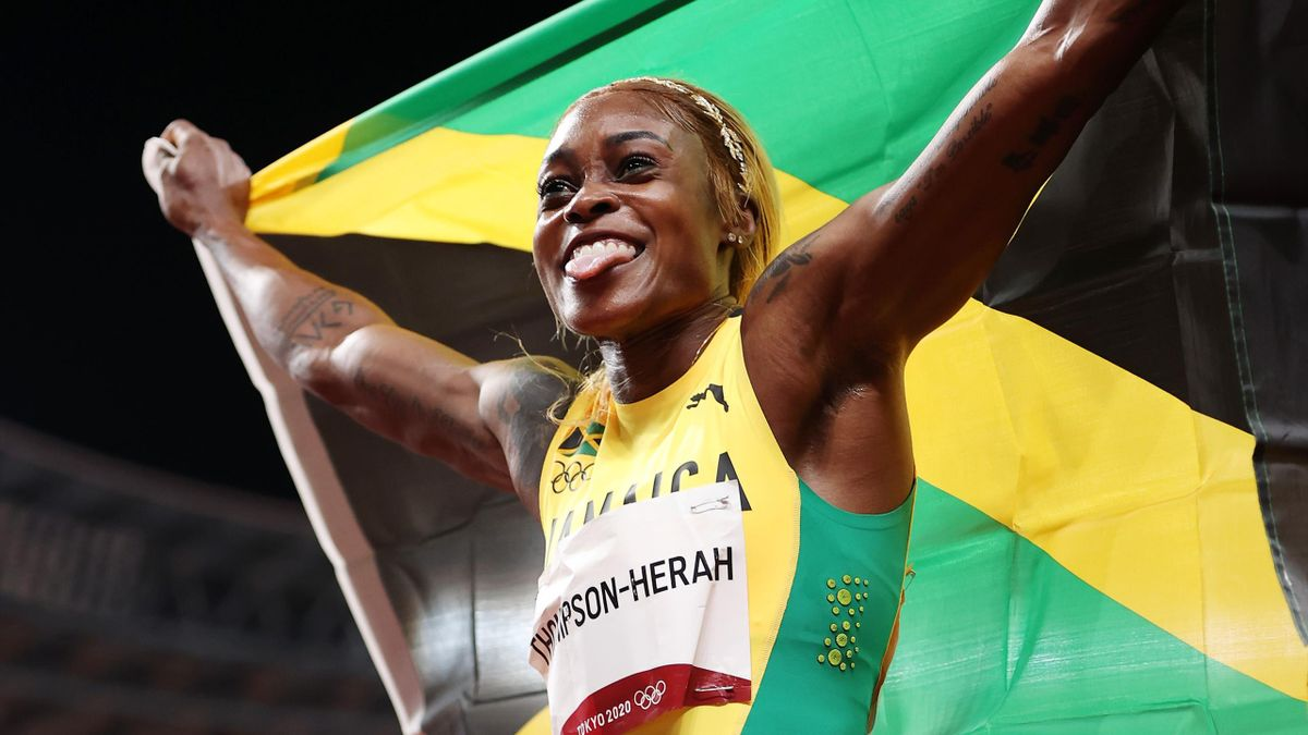 Elaine Thompson-Herah of Team Jamaica celebrates after winning the gold medal in the Women's 100m Final on day eight of the Tokyo 2020 Olympic Games at Olympic Stadium