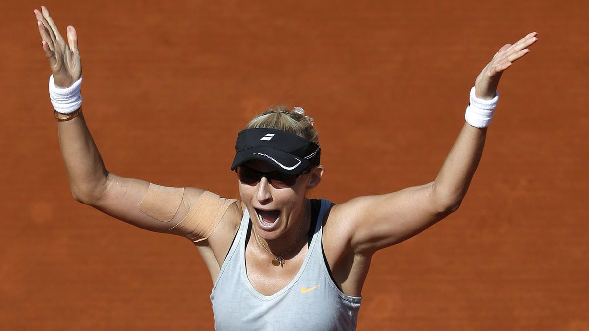 Mirjana Lucic-Baroni of Croatia celebrates after beating Simona Halep of Romania