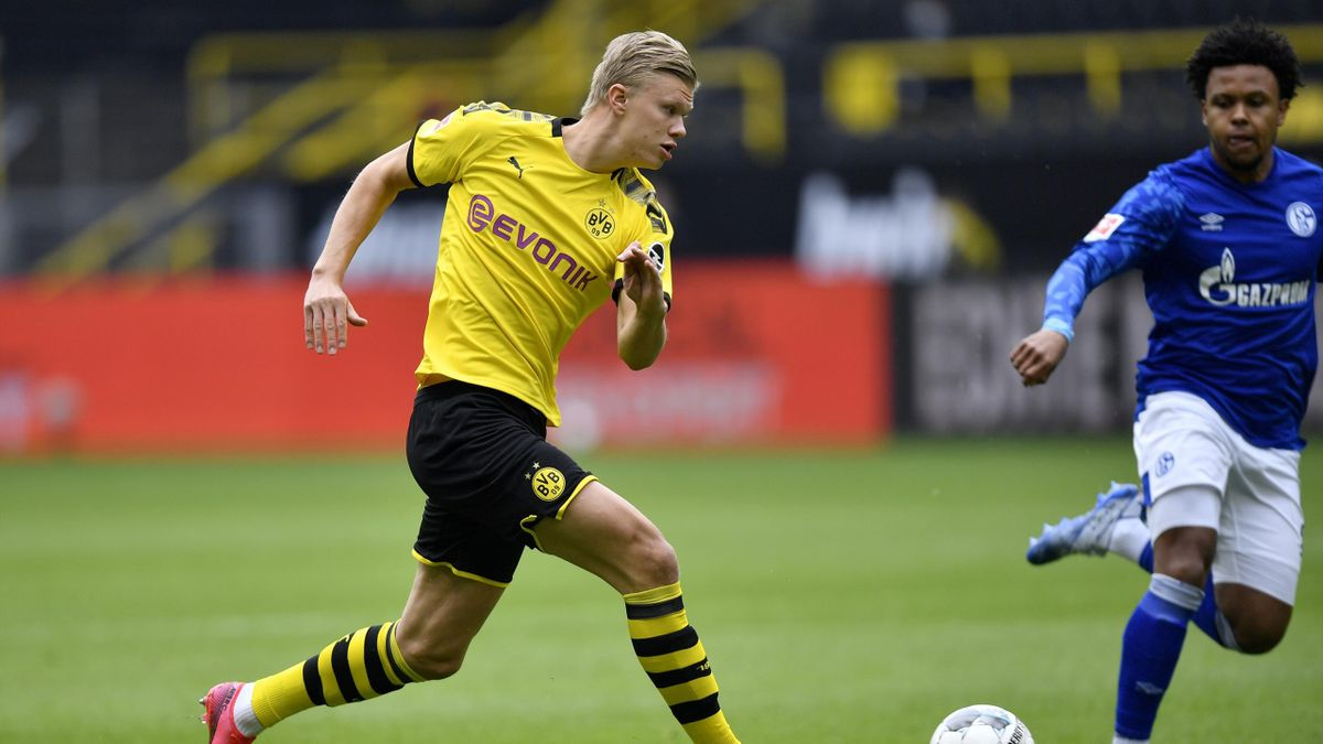 Dortmund's Norwegian forward Erling Braut Haaland runs with the ball during the German first division Bundesliga football match BVB Borussia Dortmund v Schalke 04 on May 16, 2020 in Dortmund, western Germany as the season resumed following a two-month abs