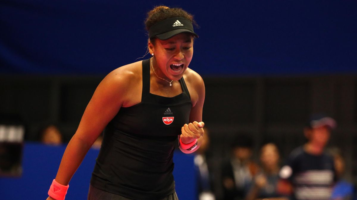 Naomi Osaka of Japan reacts in the Singles semi final against Camila Giorgi of Italy