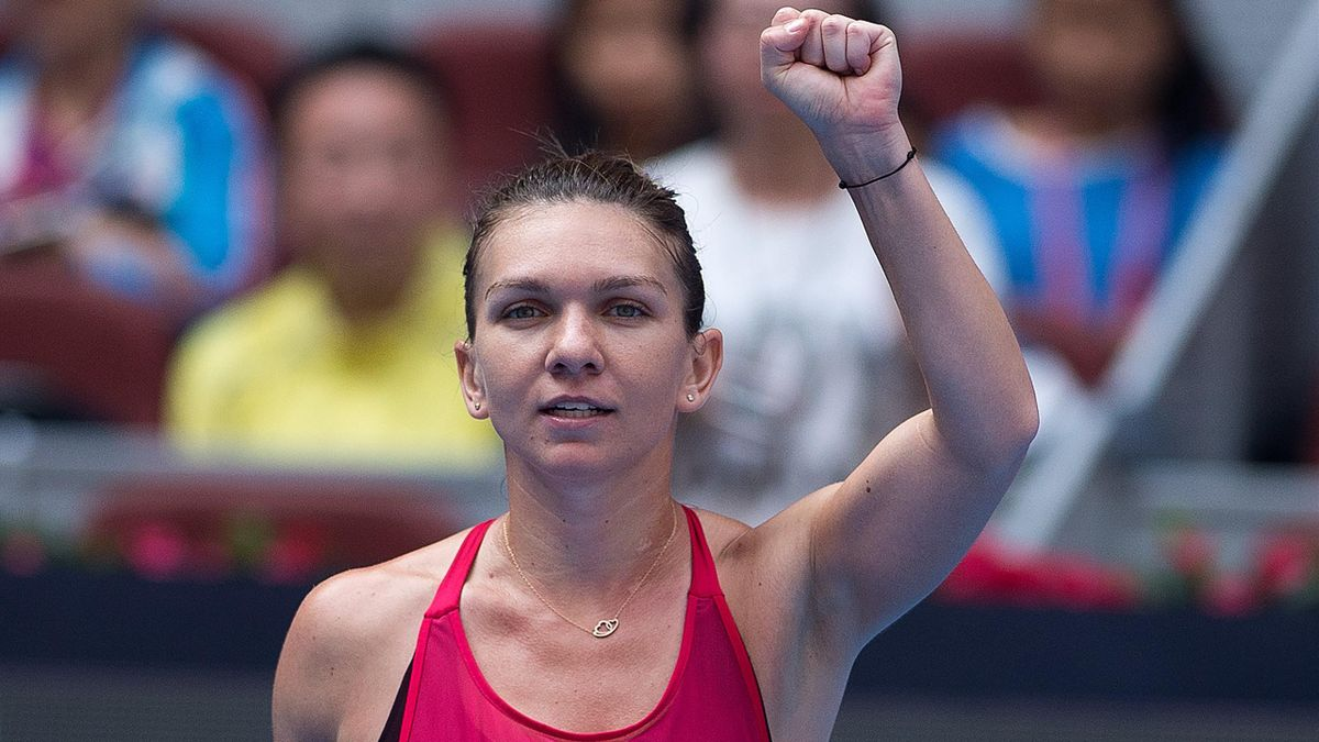 Simona Halep of Romania celebrates winning her women's singles quarter-final match against Daria Kasatkina of Russia at the China Open tennis tournament in Beijing on October 6, 2017.