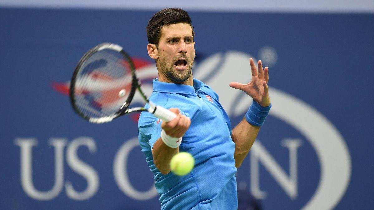 Novak Djokovic of Serbia hits a return against Stan Wawrinka of Switzerland during their 2016 US Open Men's Singles final match at the USTA Billie Jean King National Tennis Center in New York on September 11, 2016