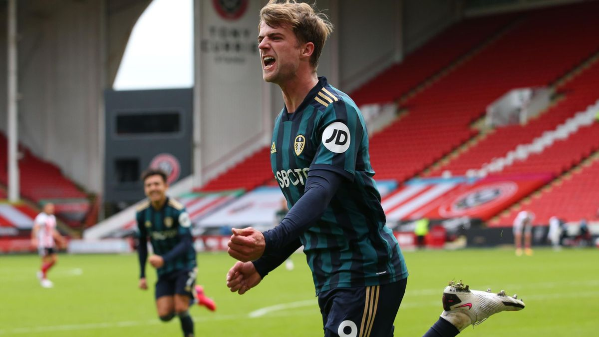 Leeds United's English striker Patrick Bamford celebrates after scoring the opening goal of the English Premier League football match between Sheffield United and Leeds United at Bramall Lane in Sheffield, northern England on September 27, 2020
