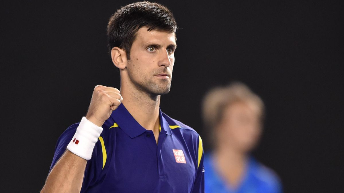 Serbia's Novak Djokovic celebrates after victory in men's singles match against France's Quentin Halys on day three of the 2016 Australian Open tennis tournament in Melbourne on January 20, 2016.