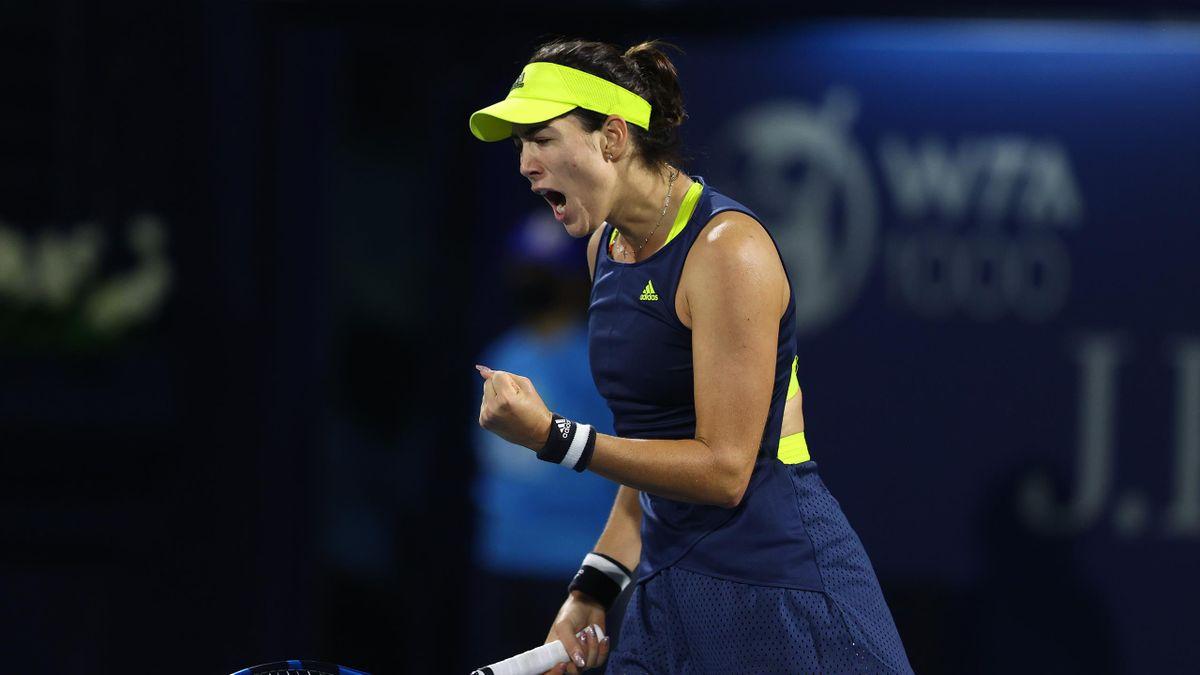 Garbine Muguruza of Spain reacts during her quarter final match with Aryna Sabalenka of Belarus during Day Five of the Dubai Duty Free Tennis at Dubai Duty Free Tennis Stadium