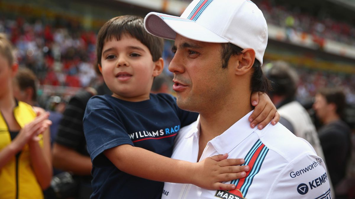 Felipe Massa of Brazil and Williams walks along the grid with his son Felipinho before the Spanish Formula One Grand Prix at Circuit de Catalunya on May 11, 2014 in Montmelo, Spain. (Photo by Paul Gilham/Getty Images)