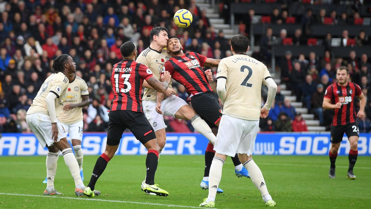Joshua King of AFC Bournemouth battles for possession with Harry Maguire of Manchester United during the Premier League match at Vitality Stadium on November 02
