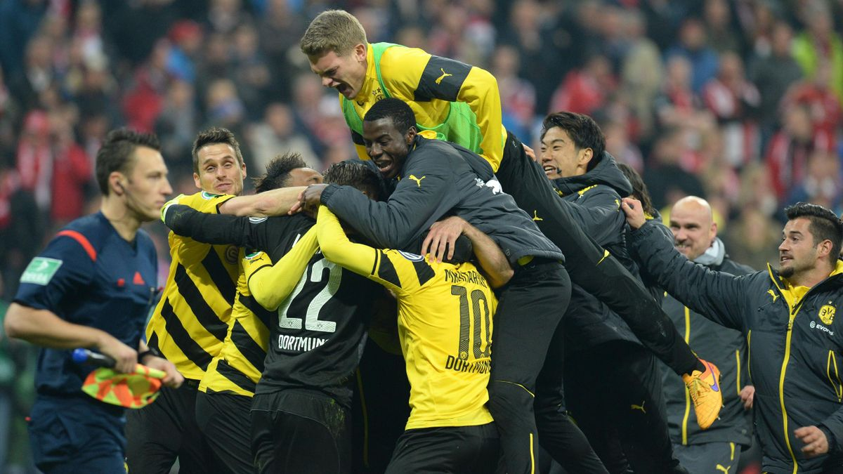 Dortmund's players celebrate after the German Cup DFB Pokal semi-final football match FC Bayern Munich v Borussia Dortmund in Munich, southern Germany