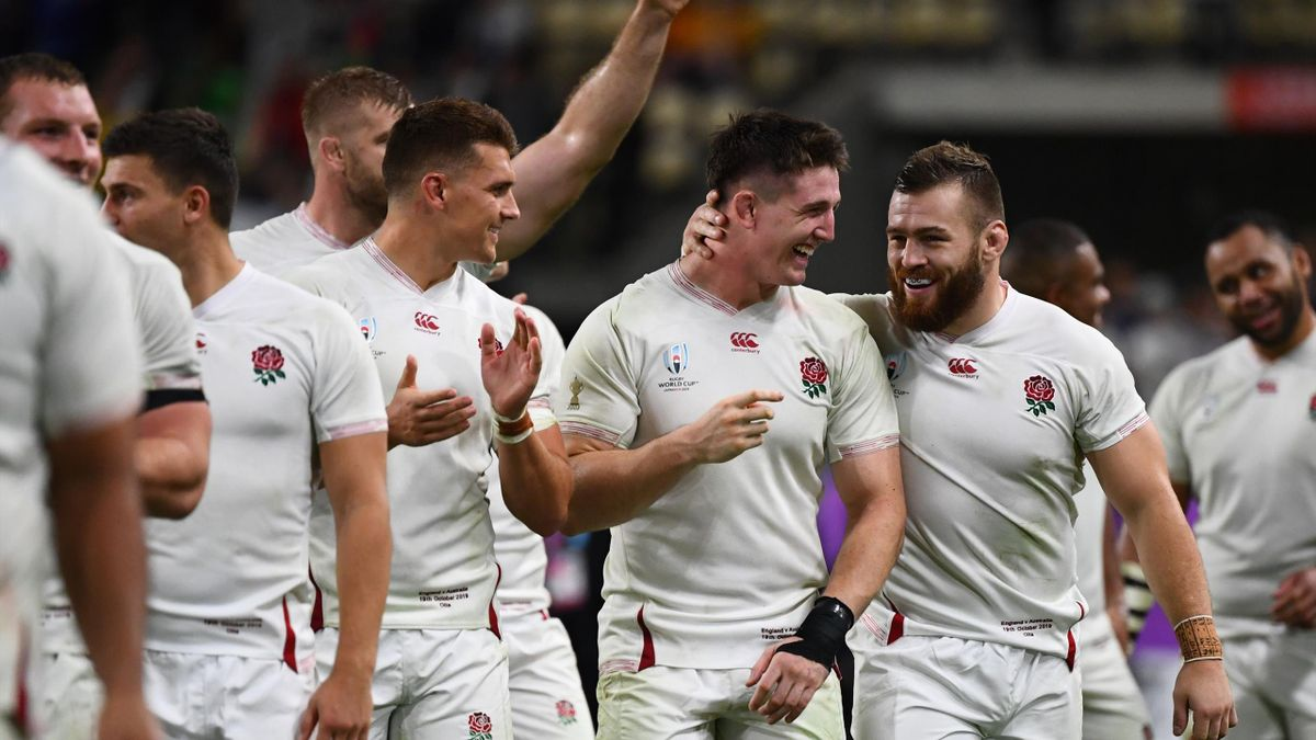England's players react after winning the Japan 2019 Rugby World Cup quarter-final match between England and Australia