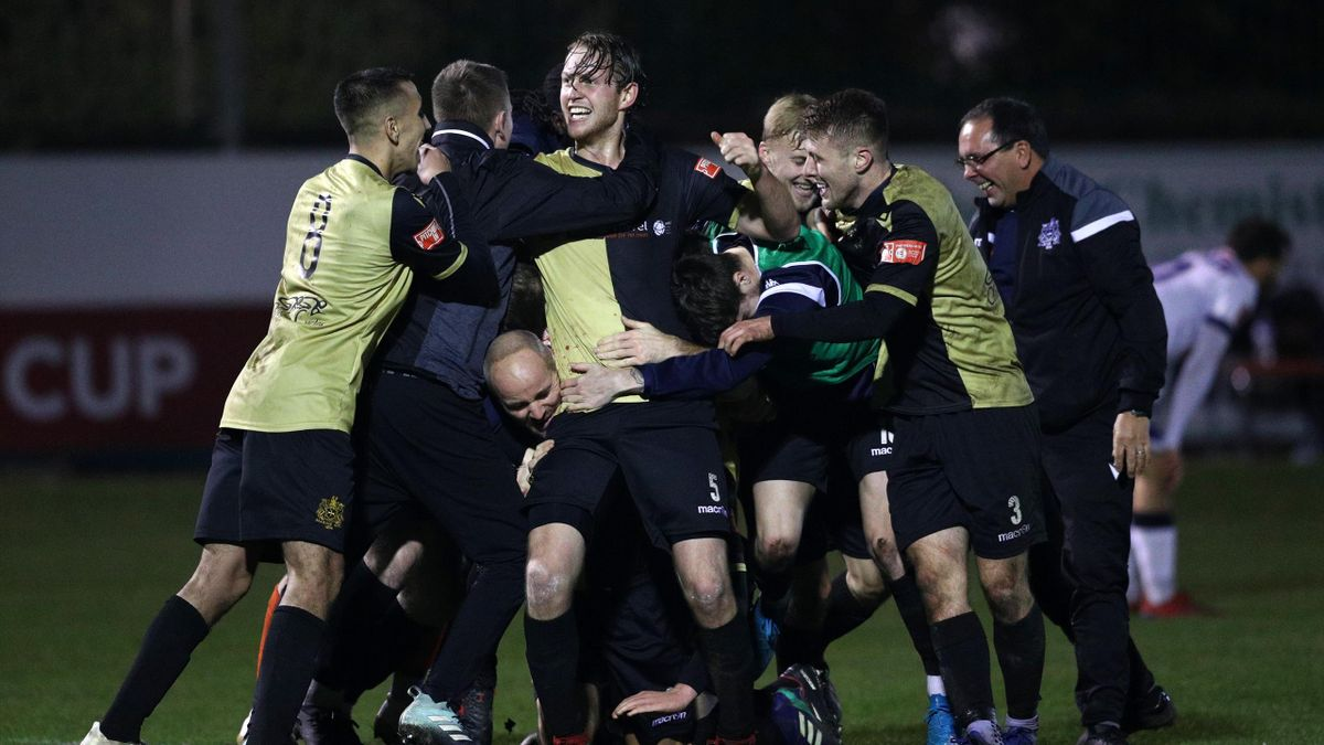 Marine players celebrate winning the match after the final whistle during the Emirates FA Cup Second Round match between Marine FC and Havant and Waterloovile