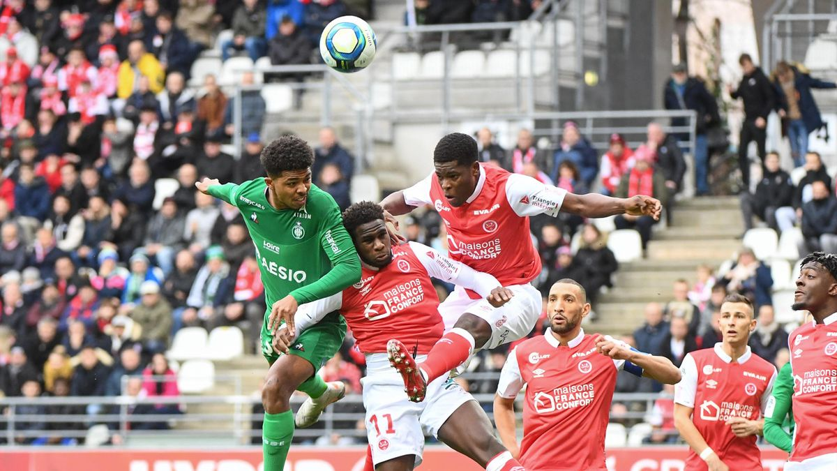 Wesley FOFANA of Saint Etienne, Boulaye DIA of Reims and Marshall MUNETSI of Reims during the Ligue 1 match between Stade Reims and AS Saint-Etienne at Stade Auguste Delaune on December 8, 2019