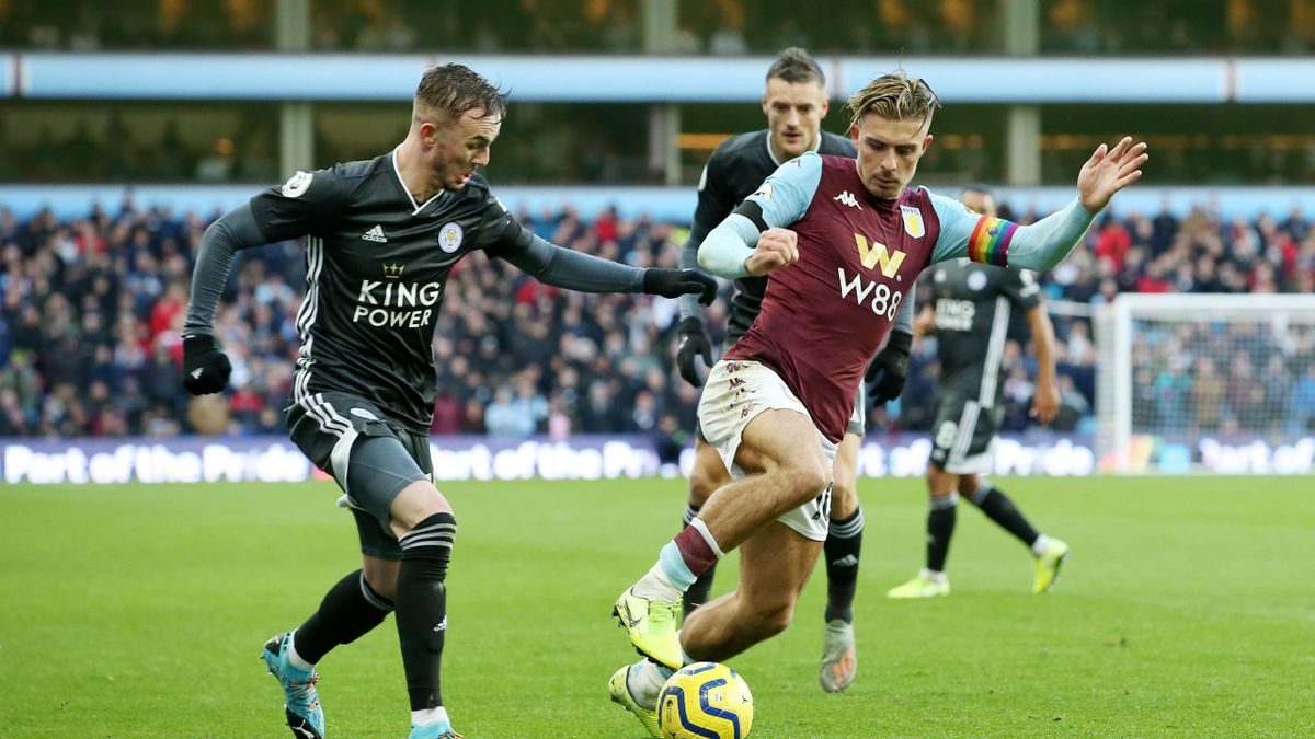 James Maddison of Leicester City in action with Jack Grealish of Aston Villa during the Premier League match between Aston Villa and Leicester City at Villa Park on December 8, 2019 in Birmingham, United Kingdom.