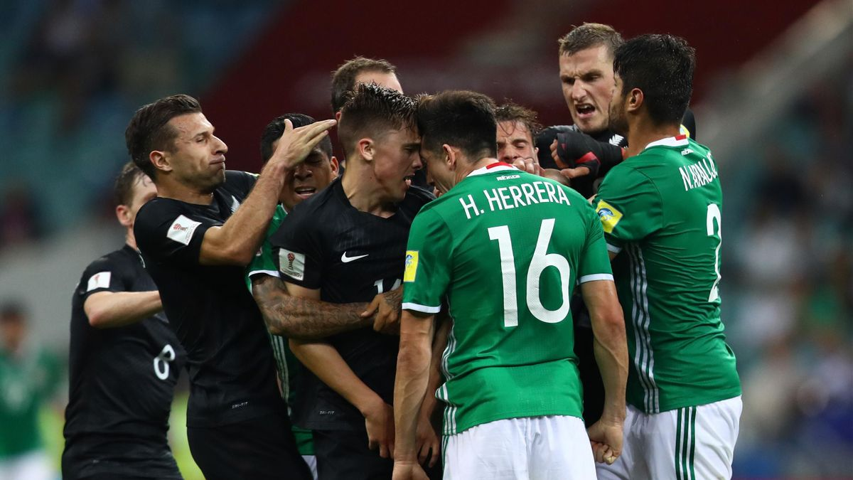 Ryan Thomas of New Zealand and Hector Herrera of Mexico clash during the FIFA Confederations Cup Russia 2017 Group A match between Mexico and New Zealand at Fisht Olympic Stadium on June 21, 2017 in Sochi, Russia