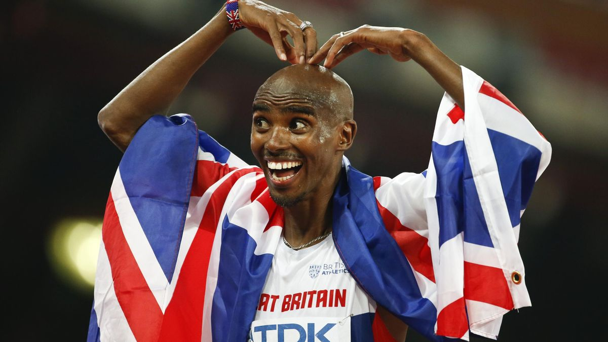 Mo Farah of Britain reacts after winning the men's 10000m event during the 15th IAAF World Championships at the National Stadium in Beijing