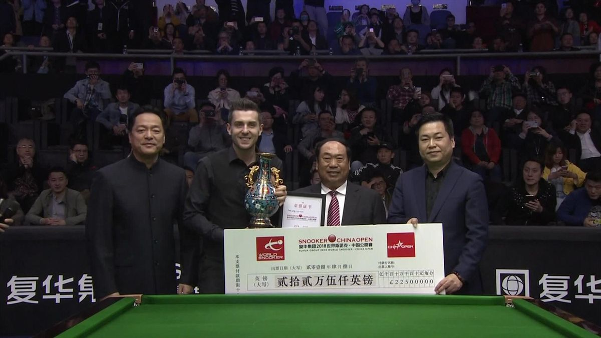 Mark Selby celebrates in Beijing.