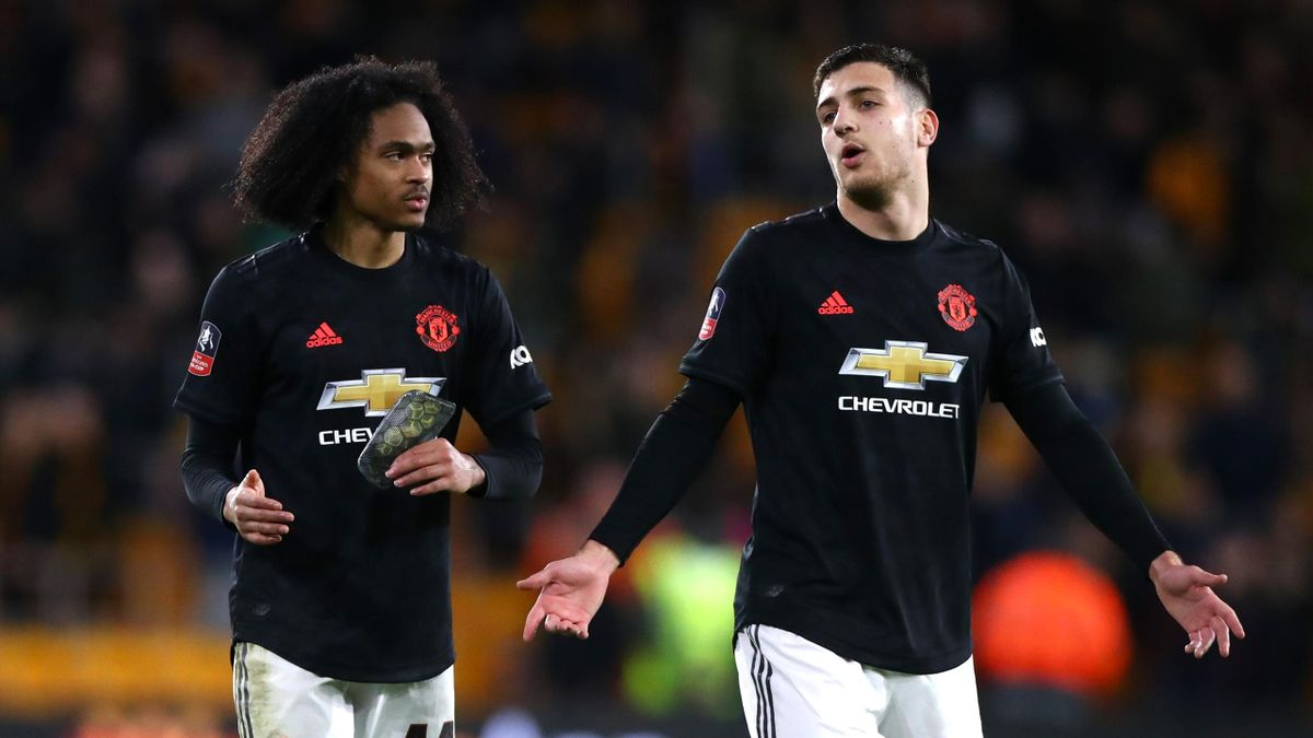Tahith Chong and Diogo Dalot of Manchester United react after the FA Cup Third Round match between Wolverhampton Wanderers and Manchester United at Molineux on January 04, 2020 in Wolverhampton, England.