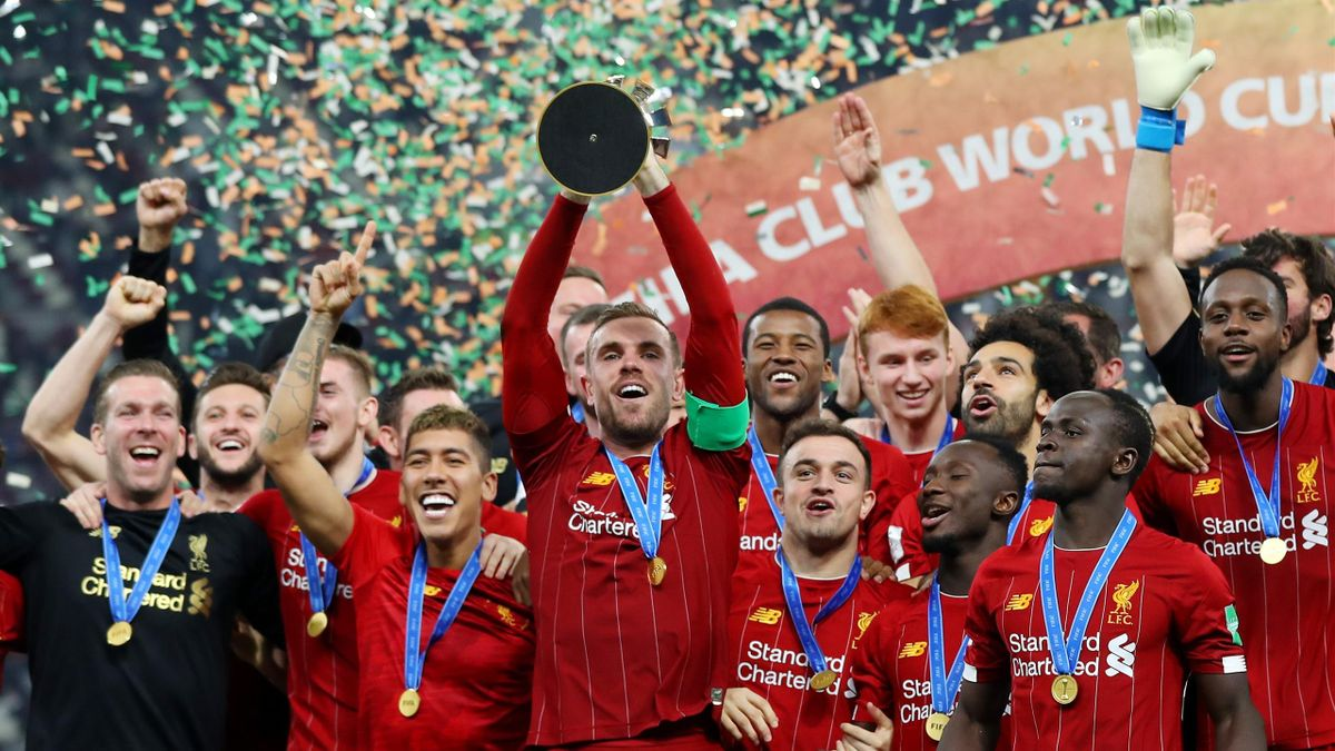 Jordan Henderson of Liverpool lifts the FIFA Club World Cup trophy following his team's victory during the FIFA Club World Cup Qatar 2019 Final between Liverpool FC and CR Flamengo at Education City Stadium on December 21, 2019 in Doha, Qatar