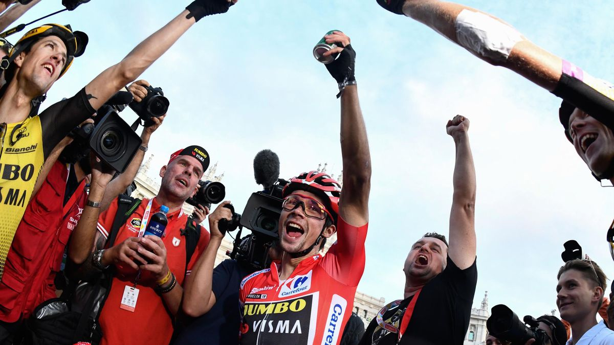 Team Jumbo rider Slovenia's Primoz Roglic (C) celebrates with his teammates after the 21st and last stage of the 2019 La Vuelta cycling Tour of Spain, a 106,6 km race from Fuenlabrada to Madrid on September 15, 2019