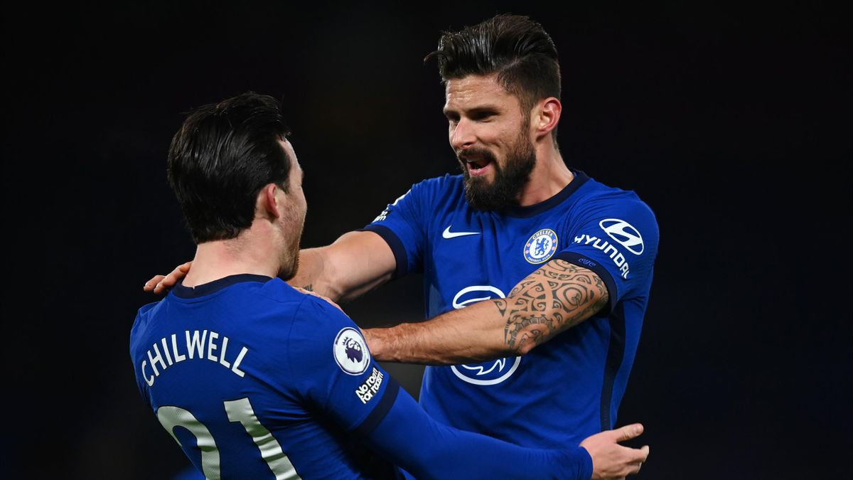 Olivier Giroud of Chelsea celebrates with team mate Ben Chilwell (l) after scoring their sides first goal during the Premier League match between Chelsea and Aston Villa at Stamford Bridge