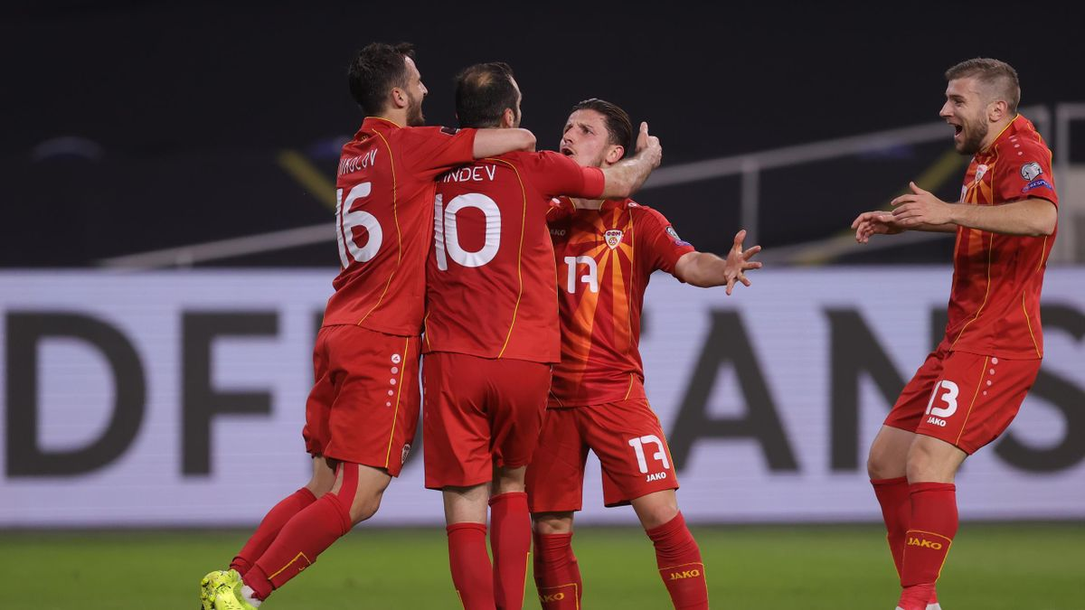 DUISBURG, GERMANY - MARCH 31: Goran Pandev of North Macedonia celebrates with team mates Boban Nikolov and Enis Bardhi after scoring their side's first goalduring the FIFA World Cup 2022 Qatar qualifying match between Germany and North Macedonia at Schaui