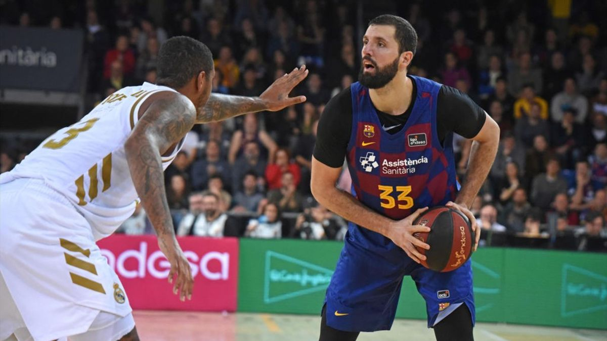 Nikola Mirotic and Trey Thompkins during the match between FC Barcelona and Real Madrid, corresponding to the week 16 of the Liga ACB, played at the Palau Blaugrana on 29 December 2019, in Barcelona, Spain.