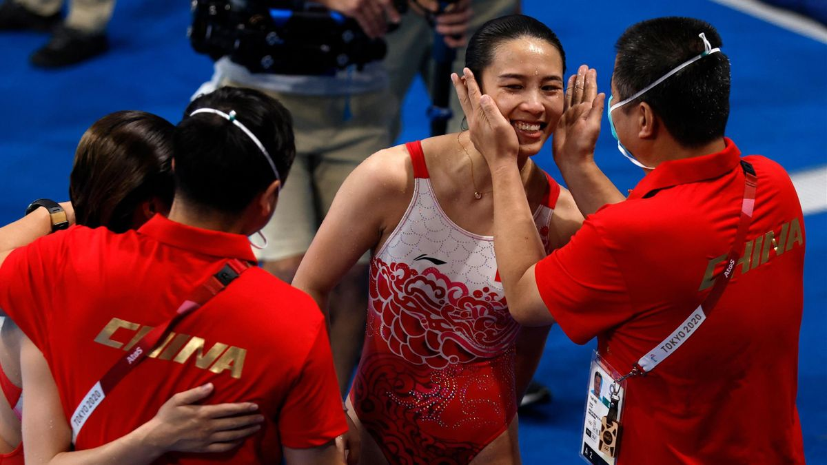 China's Shi Tingmao and China's Wang Han react after they took the gold medal in the women's synchronised 3m springboard diving final event during the Tokyo 2020 Olympic Games at the Tokyo Aquatics Centre in Tokyo on July 25, 2021. (Photo by Odd ANDERSEN
