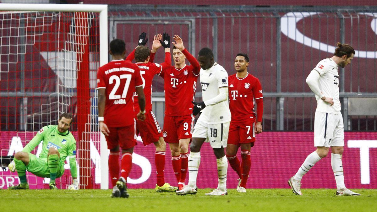 Thomas Mueller of FC Bayern Munich celebrates with teammate Robert Lewandowski after scoring his team's second goal during the Bundesliga match between FC Bayern Muenchen and TSG Hoffenheim at Allianz Arena