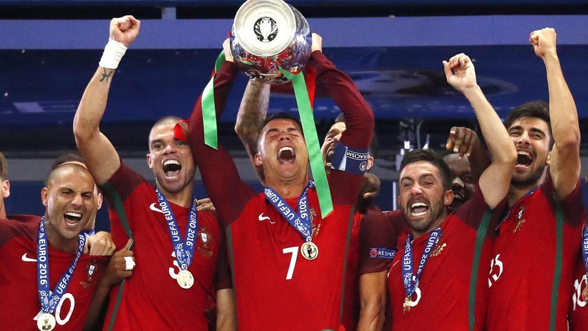 Cristiano Ronaldo liftss the Euro 2016 trophy