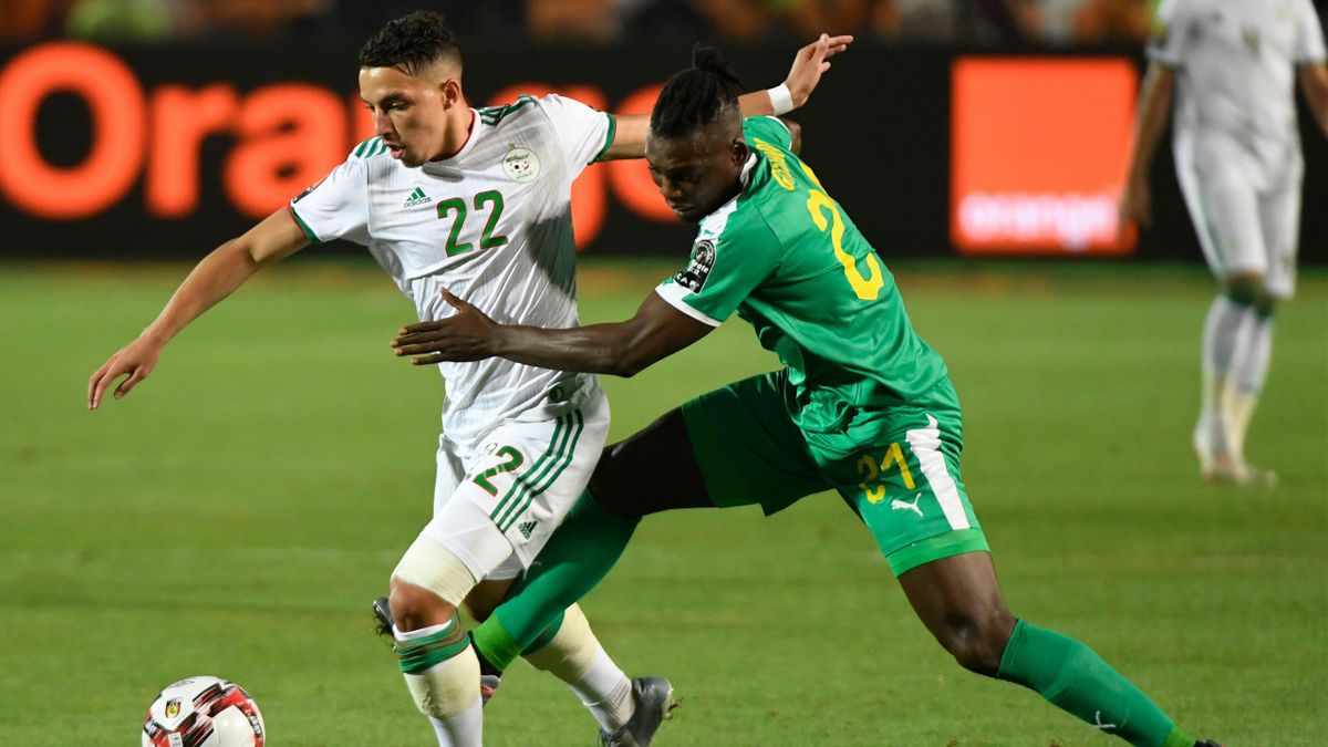 Algeria's midfielder Ismail Bennacer (L) is marked by Senegal's defender Lamine Gassama during the 2019 Africa Cup of Nations (CAN) Final football match between Senegal and Algeria at the Cairo International Stadium