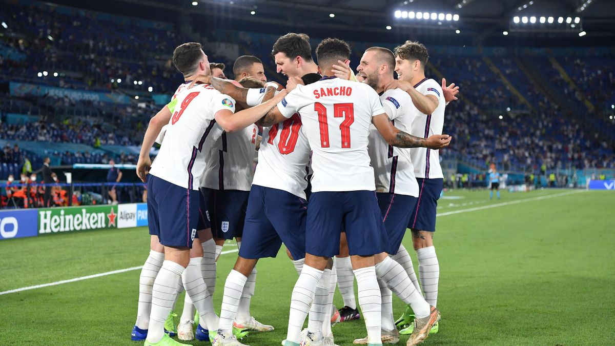 Harry Kane of England celebrates with Harry Maguire, Luke Shaw, John Stones and team mates after scoring their side's third goal during the UEFA Euro 2020 Championship Quarter-final match between Ukraine and England at Olimpico Stadium on July 03, 2021 in