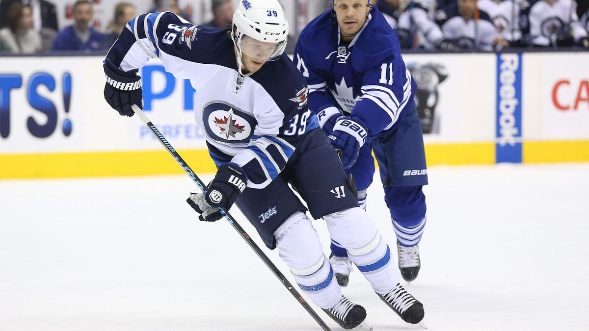 Toby Enstrom (L) will miss indefinitely with a knee injury