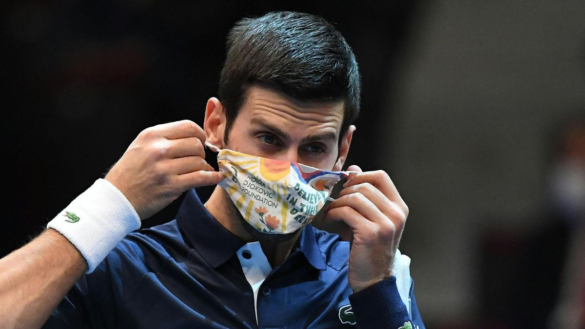 Novak Djokovic wearing a mask