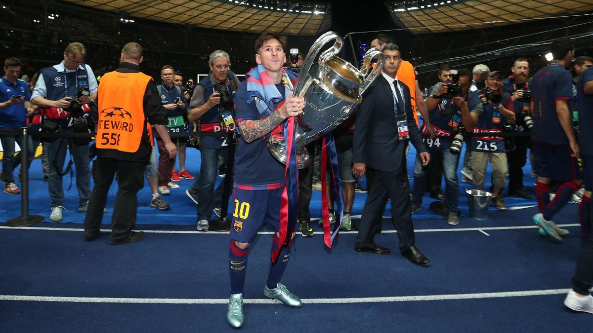 2015: Lionel Messi of FC Barcelona celebrates with the trophy following the UEFA Champions League Final match between Juventus and FC Barcelona
