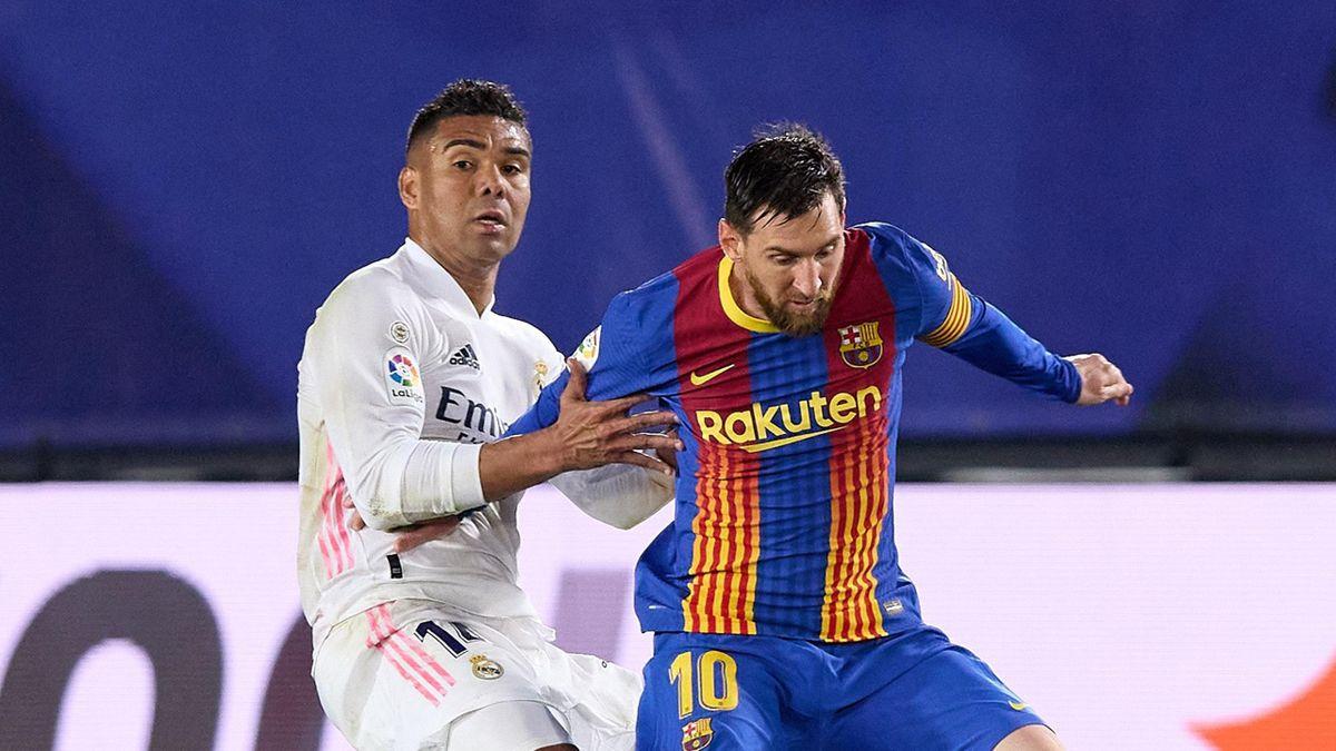 Casemiro (L) and Lionel Messi (R)