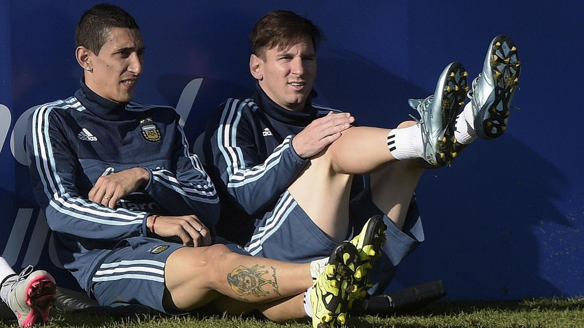 Argentina's forward Lionel Messi (R) and midfielder Angel Di Maria gesture during a training session in La Serena, Coquimbo, Chile on June 17, 2015