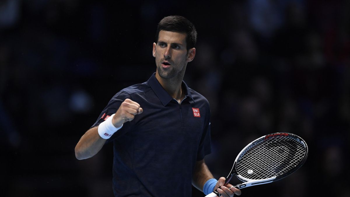 Serbia's Novak Djokovic celebrates winning his semi final match against Japan's Kei Nishikori