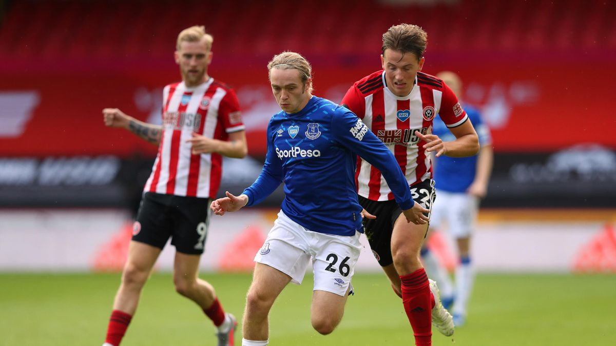Tom Davies of Everton holds off a challenge from Sander Berge of Sheffield United during the Premier League match between Sheffield United and Everton FC at Bramall Lane on July 20, 2020 in Sheffield, England. Football Stadiums around Europe remain empty