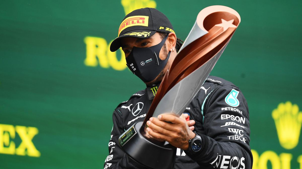 Race winner Lewis Hamilton of Great Britain and Mercedes GP celebrates winning a 7th F1 World Drivers Championship on the podium during the F1 Grand Prix of Turkey at Intercity Istanbul Park on November 15, 2020 in Istanbul, Turkey